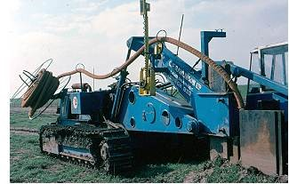 Fig. 10. Example of specialized heavy equipment, often employing laser-guided gradient sensing, to install subsurface plastic drainage pipes in arable farmland