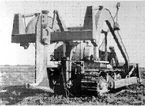 Fig. 11. A prototype, laser-guided mole drainer built by the Agricultural Research Service of the United States Department of Agriculture. The 'mole' is the bullet-shaped foot of the vertical knife that is drawn through the soil.